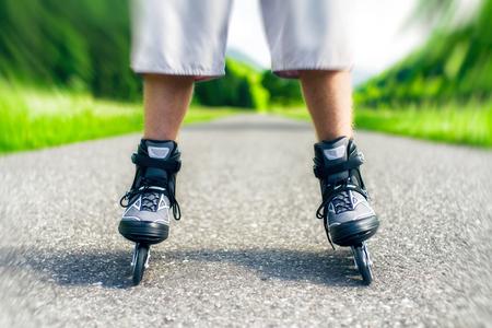 Roller skates. Inline skating on asphalt road. Stock Photo