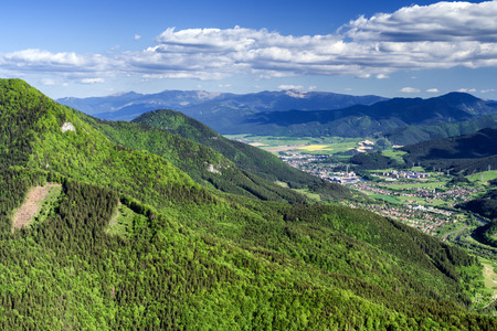 ruzomberok: Beautiful view from hill Hrdos (Ostre) in Mala Fatra national park. Country landscape. Town Ruzomberok at backround