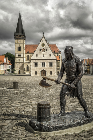 Statue of medieval executioner on the square of Unesco town Bardejov, Slovakia