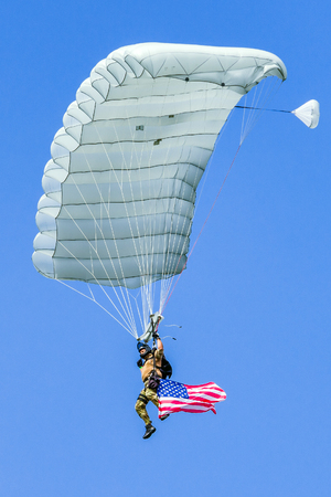 SLIAC, SLOVAKIA - AUGUST 27: Parachutist with waving american flag at airshow SIAF 2017 on August 27, 2017 in Sliac