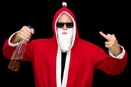 Santa Claus with bottle of alcohol on black backround