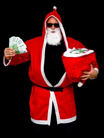 Santa Claus with bag full of euro money Stock Photo