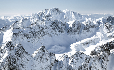 Beautiful snowy peaks in winter. View from peak Lomnicky stit in High Tatras mountains, Slovakia
