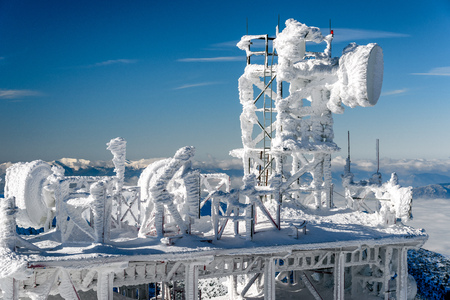 Cold winter in mountains - frozen satellites
