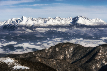 Snowy winter peaks in High Tatras from hill Chopok in Low Tatras mountains, Slovakia