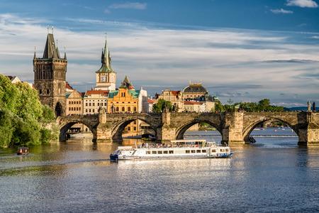 PRAGUE, CZECH REPUBLIC - JULY 1:  Charles bridge and cruiseship on river Vltava on July 1, 2017 in Prague