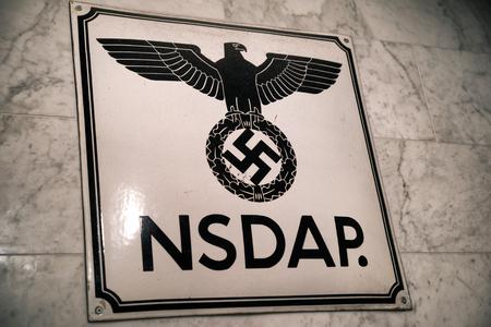 KRAKOW, POLAND - FEBRUARY 19: Swastika and logo of NSDAP in Oskar Schindlers Enamel factory museum on February 19, 2018 in Krakow