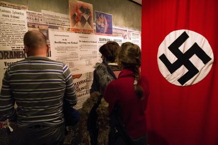 KRAKOW, POLAND - FEBRUARY 19: Swastika - flag in Oskar Schindlers Enamel factory museum on February 19, 2018 in Krakow