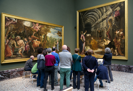 MILAN, ITALY - APRIL 14: Visitors looking at Tintoretto painting The Finding of the Body of Saint Mark in gallery Pinacoteca di Brera on April 14,2 018 in Milan