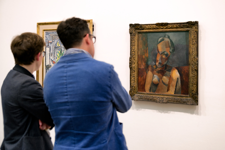 LONDON, UNITED KINGDOM - MAY 12: Visitors looking at Pablo Picasso paintings at Tate modern on May 12, 2018 in London