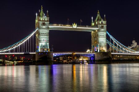 Tower bridge and river Thames at night in London, Great Britain