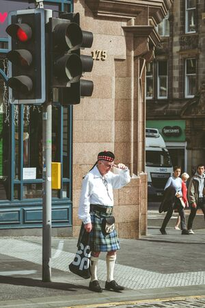 EDINBURGH, SCOTLAND - MAY 18: Scotsman in traditional Scottish cloth - kilt in centre of city on May 18, 2018 in Edinburgh