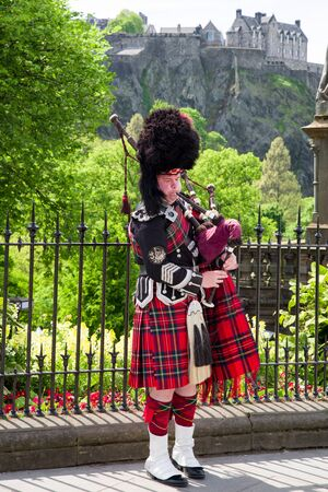 EDINBURGH, SCOTLAND - MAY 19: Scottish piper playing on bagpipe in the centre of city on May 19, 2018 in Edinburgh