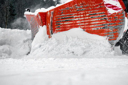 Snow plough vehicle on road. Close up view