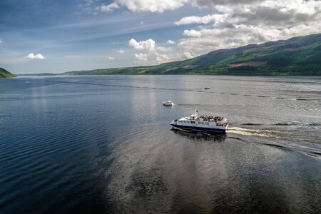 LOCH NESS, SCOTLAND, MAY 23: Cruise ship on lake Loch Ness full of tourists on May 23, 2018 in Loch Ness Editorial