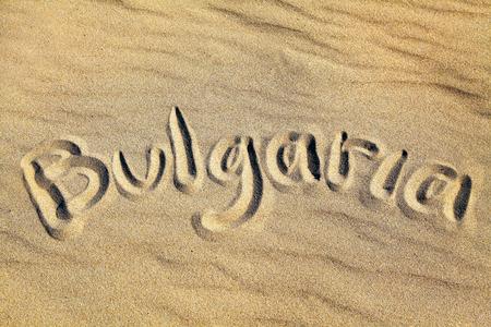 Text BULGARIA in sandy beach Stock Photo