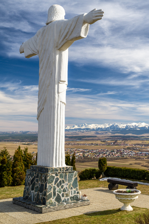 Monumental statue of Jesus Christ at Klin in Slovakia. Region Orava and High Tatras at background.