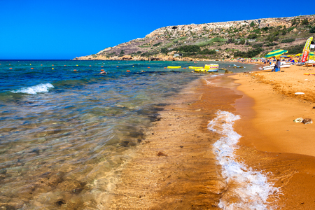 RAMLA BAY, MALTA - JULY 20: Orange sand at Ramla Bay on July 19, 2015 in Ramla Bay