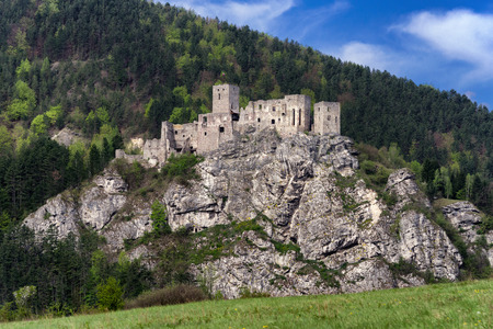 Strecno castle on the cliff, Slovakia. Lookout Spicak at background