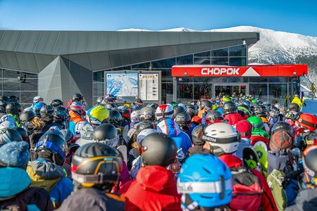 DEMANOVSKA DOLINA, SLOVAKIA - FEBRUARY 8: Many skiers in front of cableway Funitel in ski resort Jasna on February 8, 2020 in Demanovska Dolina Editorial