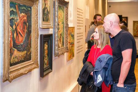 RUZOMBEROK, SLOVAKIA - SEPTEMBER 19: Visitors looking at Ludovit Fulla painting in his gallery on September 19, 2019 in Ruzomberok