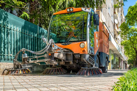 RUZOMBEROK, SLOVAKIA - MAY 22, 2020 - Street cleaner vehicle, road sweeper cleaning on the pavement in city of Slovakia Editorial