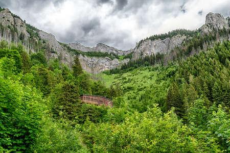 Tarn Velicke pleso and Velicky waterfall in High Tatras mountains, Slovakia. Stock Photo - 151310899