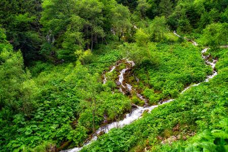 Tarn Velicke pleso and Velicky waterfall in High Tatras mountains, Slovakia.