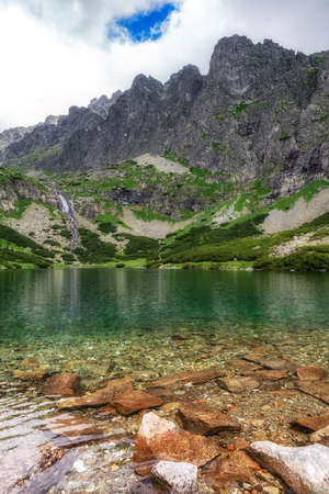 Tarn Velicke pleso and Velicky waterfall in High Tatras mountains, Slovakia. Stock Photo - 151309812