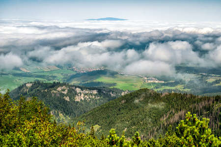View from top of the hill Sivy vrch in Western Tatras at Slovakia through inversion. Hill Babia Hora at background. Stock Photo - 153480308