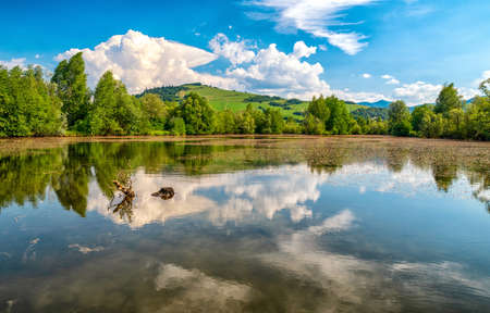 Reflection of clouds on water surface. Pond called Parnicke rybniky, Slovakia