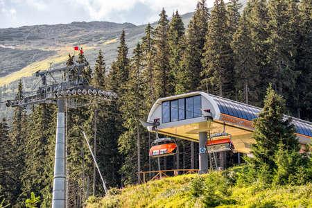 DEMANOVSKA DOLINA, SLOVAKIA - AUGUST 24, 2020: Modern ski lift chair in resort Jasna in Low Tatras mountains Editorial