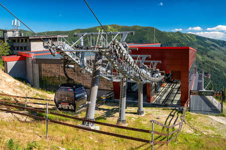 HORNA LEHOTA, SLOVAKIA - AUGUST 21, 2020: Cabins of ropeway and station of cableway in resort Chopok-Juh