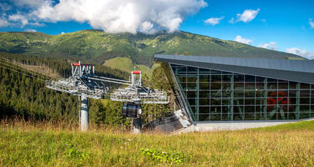 DEMANOVSKA DOLINA, SLOVAKIA - AUGUST 24, 2020: Station of cableway Funitel in resort Jasna in Low Tatras mountains Stock Photo - 155241922