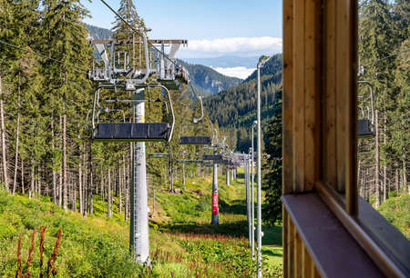 DEMANOVSKA DOLINA, SLOVAKIA - AUGUST 21, 2020: Ski lift chairs in resort Jasna in Low Tatras mountains