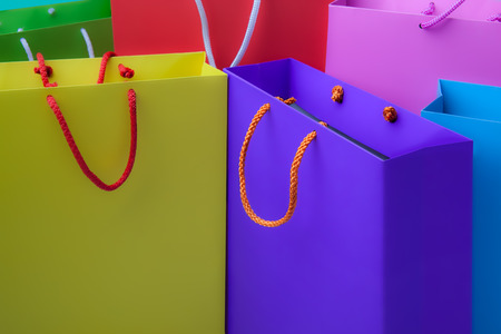 Colourful paper shopping bags with copy space photo