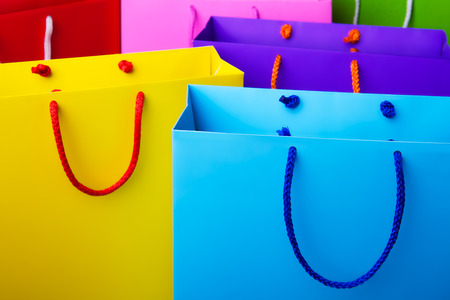christmas shopping bag: Colorful paper shopping bags with copy space  - Pink, blue, red, yellow and green shopping bags