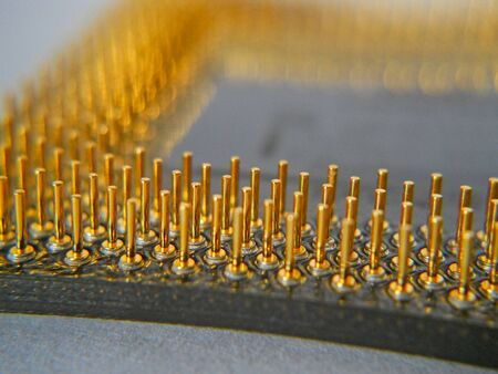 Microprocessor gold contacts on the paper -close up