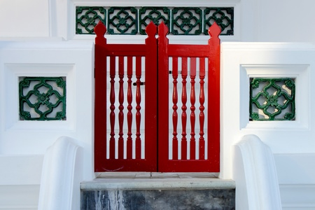 red door on white wall