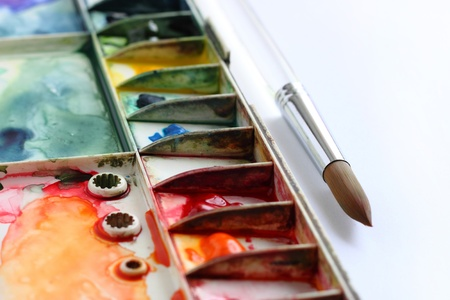 watercolor palette and Paintbrush Stock Photo