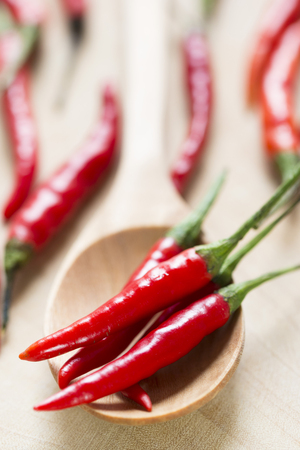 red chili pepper on wooden table,closeup view