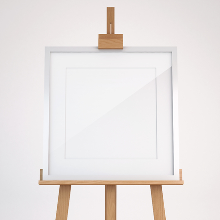 Wooden easel with picture frame Stock Photo