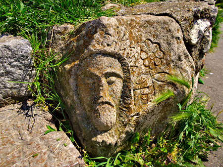 belgrade: Face of a man on old ruined wall closeup.