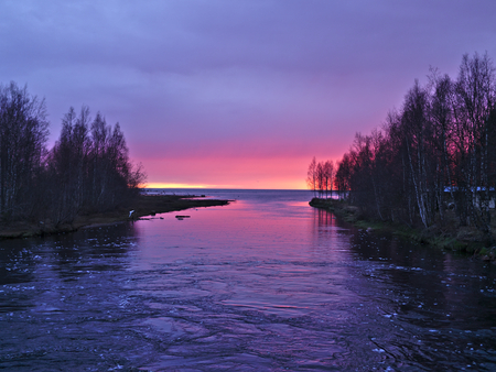 Beautiful red sky at river delta after sunset. Natural background. Stok Fotoğraf