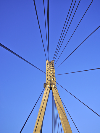 Pylons and cables of cable-stayed bridge. Architectural background.