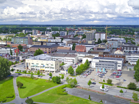 View over town of Sein?joki in Finland. Green urban landscape. Imagens