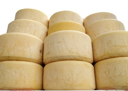 basque country: Cheese - stacks of Idiazabal cheese on a market in the Basque Country Stock Photo
