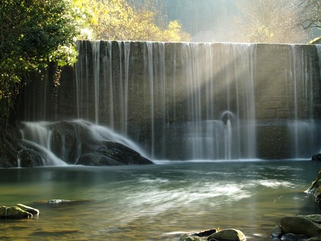 A scenic waterfall stream in silky effect. Stock Photo - 8041920