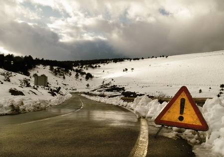 Warning sign in the road at Winter photo