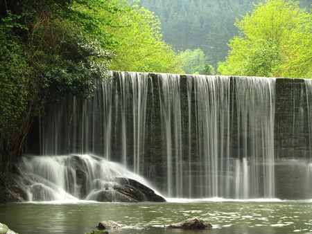 A scenic waterfall stream in silky effect. Stock Photo - 8356787